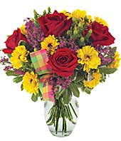 Red roses, yellow viking poms and heather in arrangement