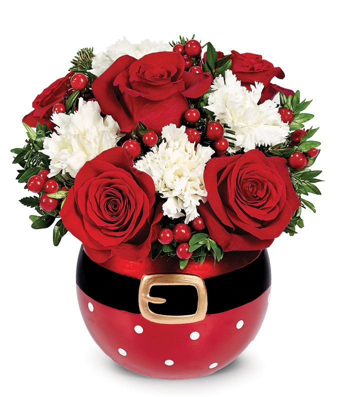 Red and white flowers in a santa vase