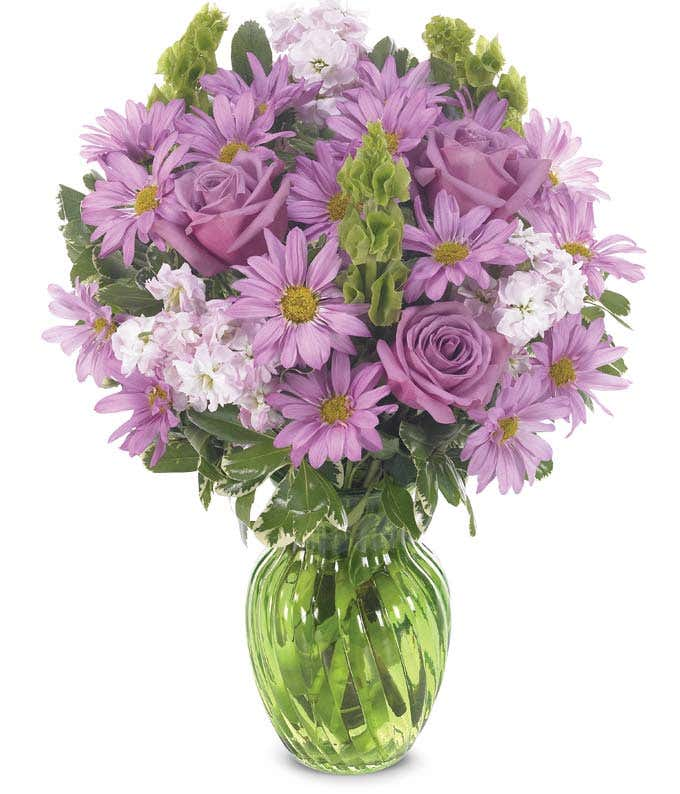 Arrangement with purple roses, daisies and bells of Ireland