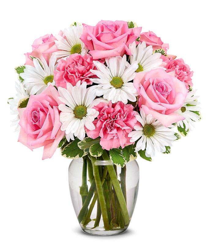 Pink roses, pink carnations and white daisies in a pink vase
