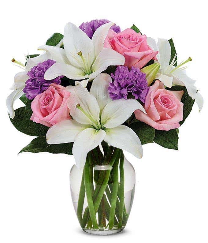pink roses, purple carnations and white lilies