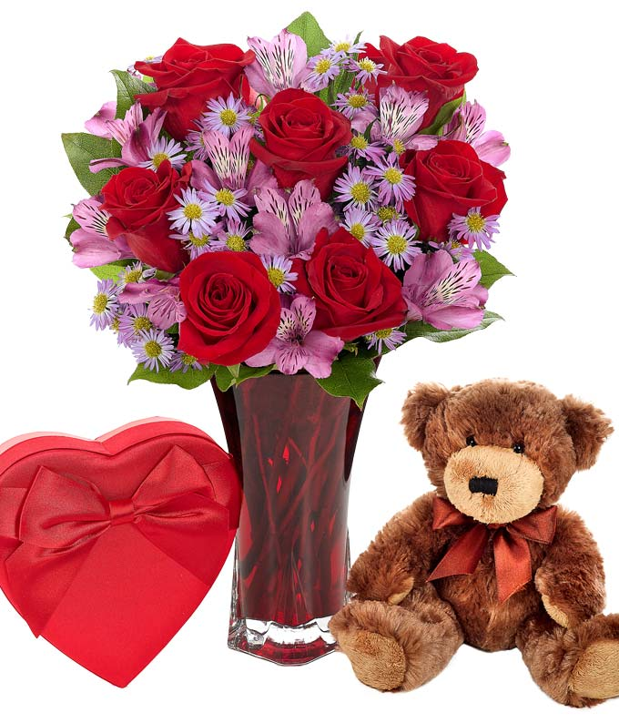 Teddy bear with flowers and chocolates