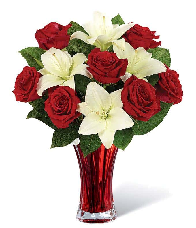 Red roses, white lilies in a red vase