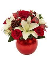 Red and White flowers in a red ornament vase