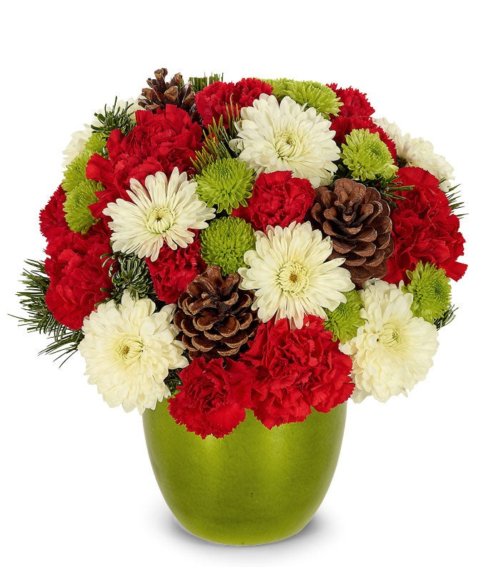Red, white and green flowers in a green vase