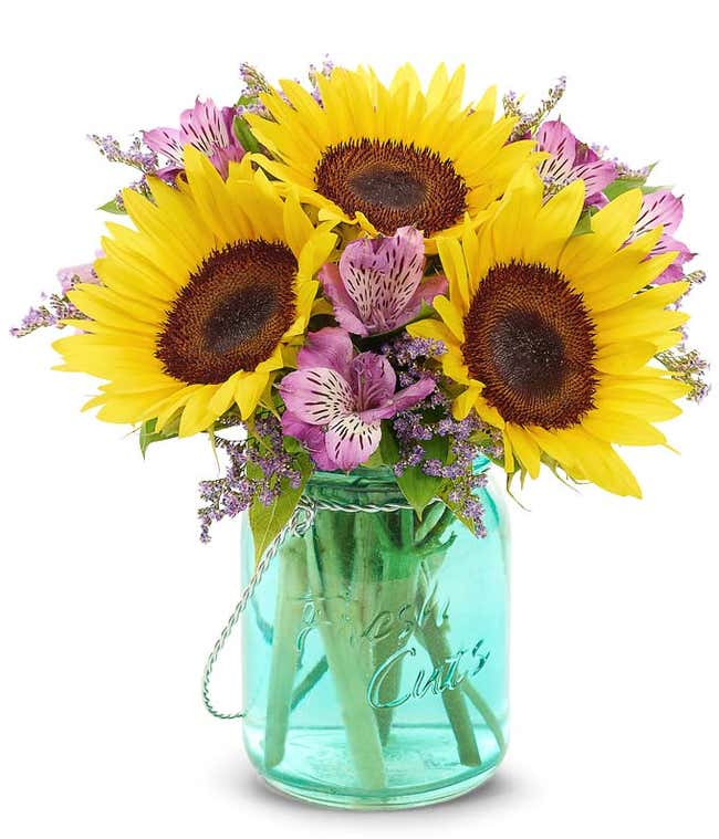 Sunflowers in mason jar vase