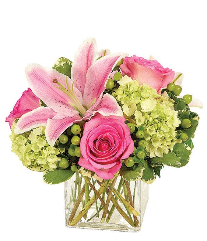 Pink lilies and pink roses with green hydrangea