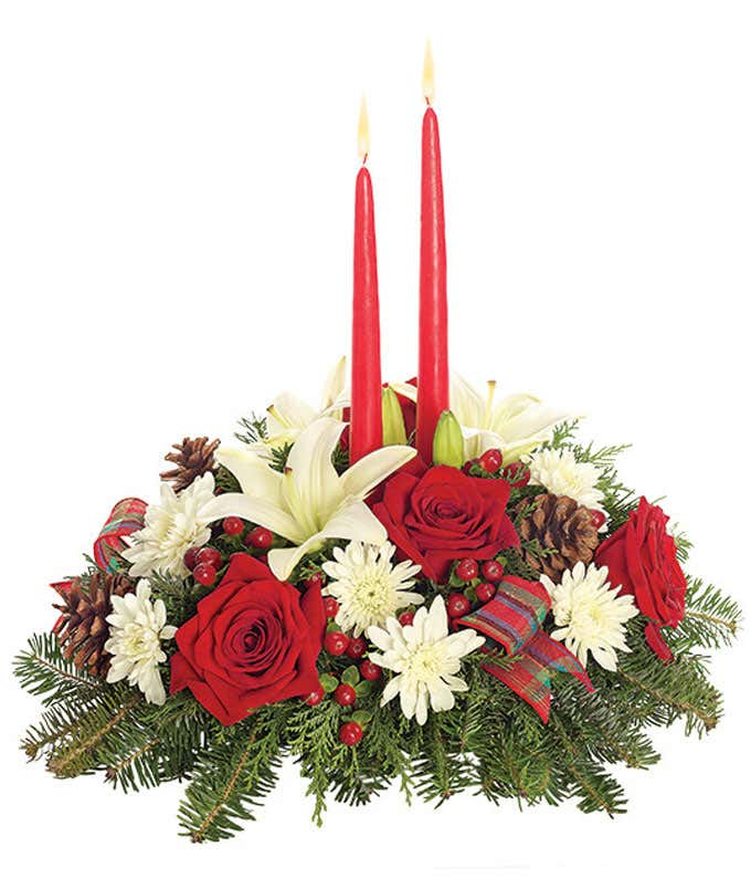 Red roses, white lilies, hypericum berries and red candle centerpieces.