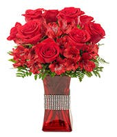 red roses and red alstroemeria delivered in a tall red vase