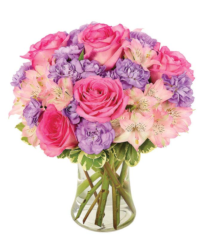 Pink roses with purple flowers in a playful bouquet