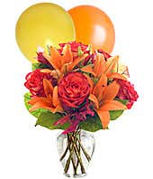 Orange roses, orange lilies and orange & yellow balloons