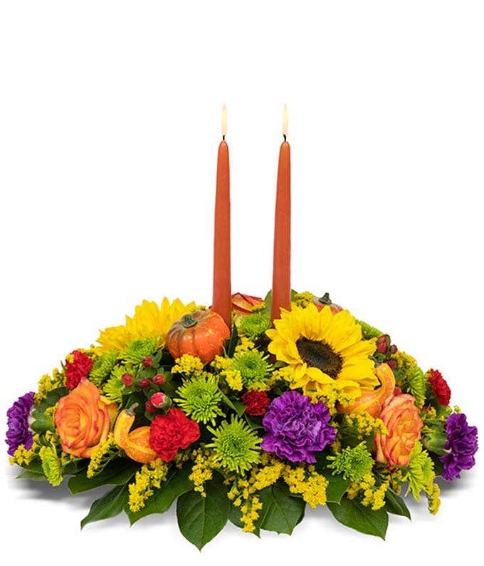 Sunflowers and pumpkin candled centerpiece