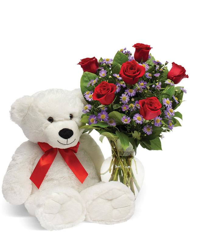 White teddy bear with red roses and purple monte casino
