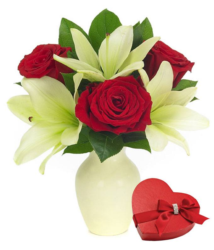 Red roses and white lilies delivered with Valentine's chocolates