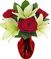 Red roses and white lilies in a red vase