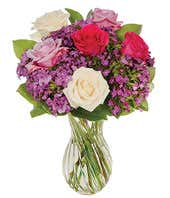 Purple roses, white roses and hot pink rose arrangement