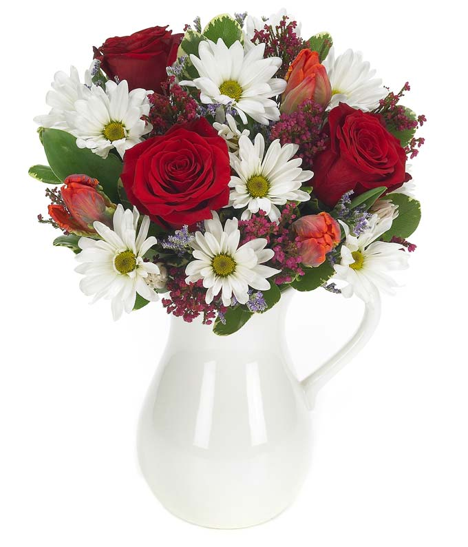 Red roses and white daisies in a reusable pitcher