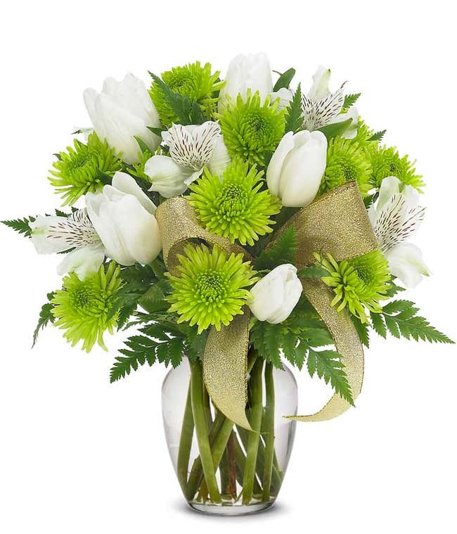 St. Patrick's Day flowers with green mums and tulips in a glass vase
