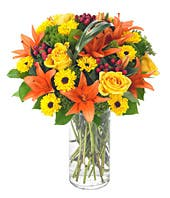 Orange lilies, yellow roses and yellow daisies