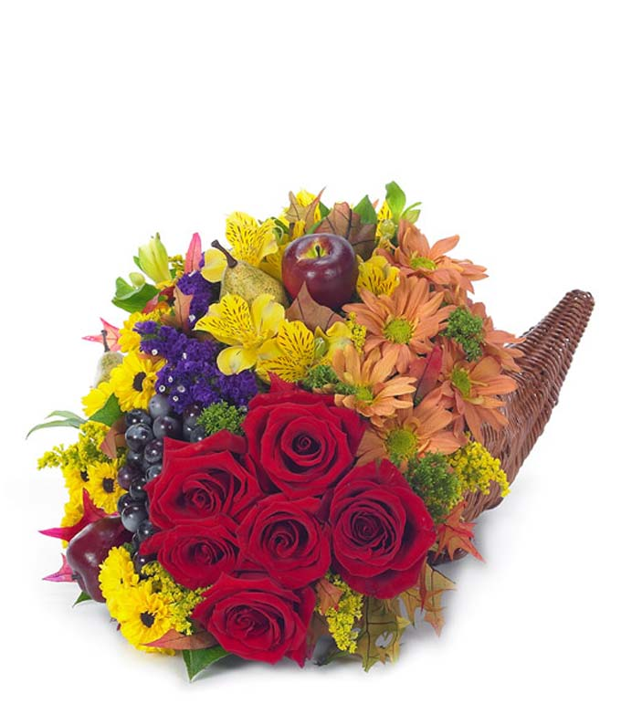 Classic Thanksgiving cornucopia hand delivered by a florist with fresh flowers