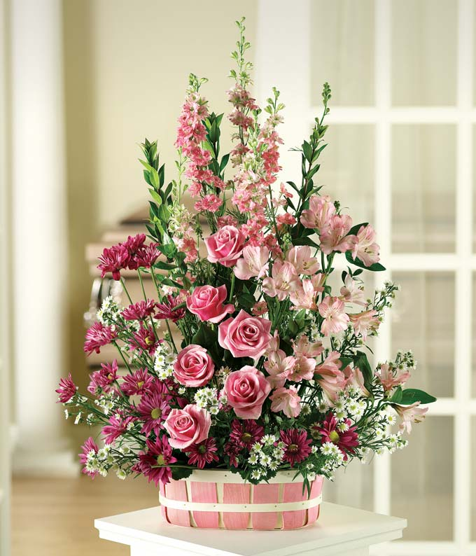 Pink roses and pink alstroemeria in a basket