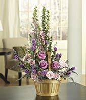 Purple and pink roses in a woven basket
