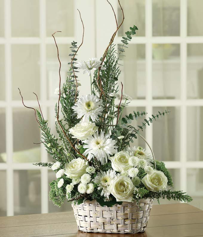 Sympathy floral basket with white roses, mums and greenery