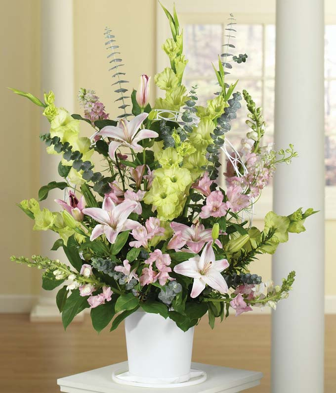 Green & Pink funeral flowers delivered by florist.