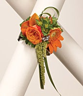 Orange flower wrist corsage