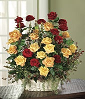 Red roses, orange roses and huckleberry in bouquet