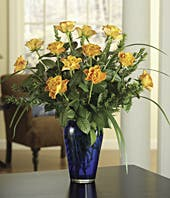 Sympathy bouquet with Orange Roses, Salal & Lily Grass