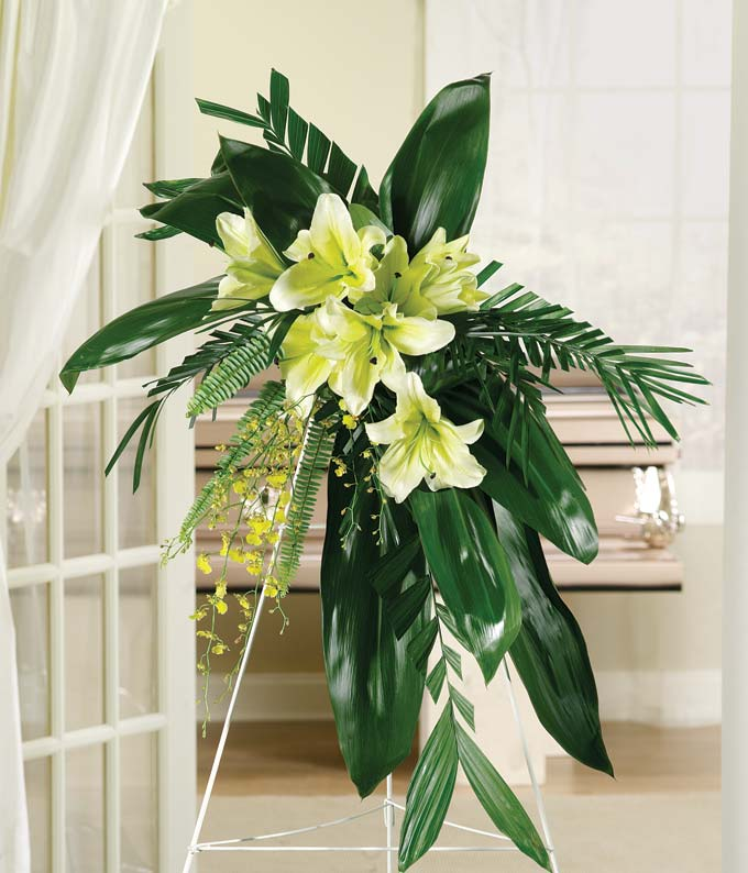 Yellow lily and yellow orchid standing spray