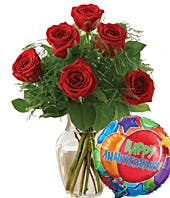 half dozen red roses with a happy anniversary balloon