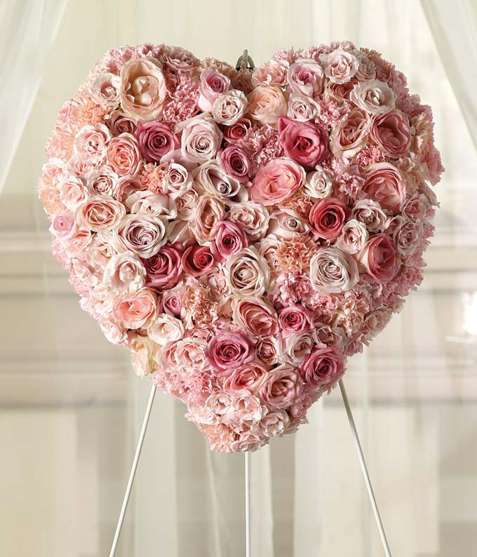 Pink roses and light pink roses in heart-shaped standing spray