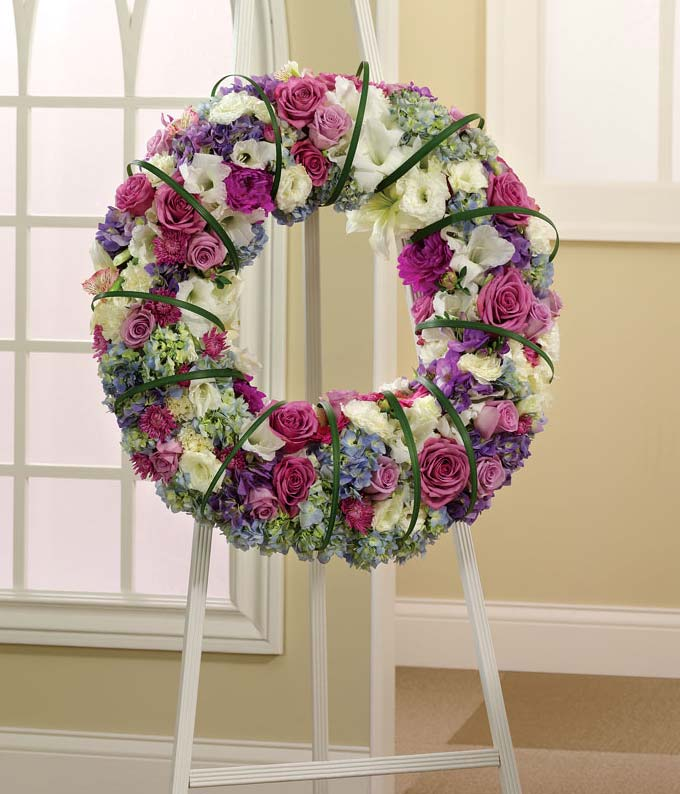 Pink, purple, white and blue standing wreath of roses