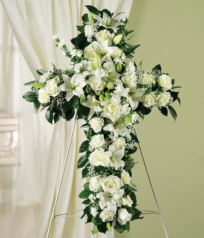 Sympathy standing spray with white roses, lilies and carnations