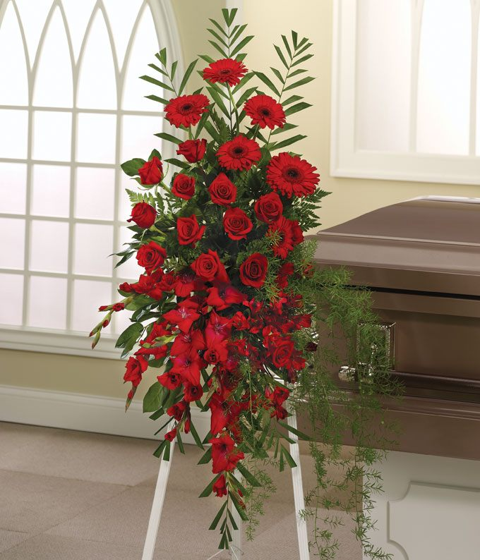 Standing spray of red roses, alstroemeria, and gladiolus