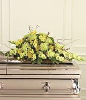 flower casket spray with yellow flowers