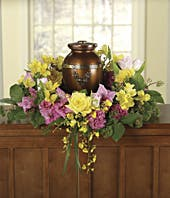 Pink carnations and yellow rose urn floral bouquet