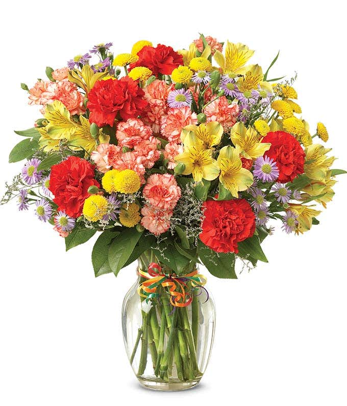 Red carnations, yellow alstroemeria and poms in a celebration bouquet