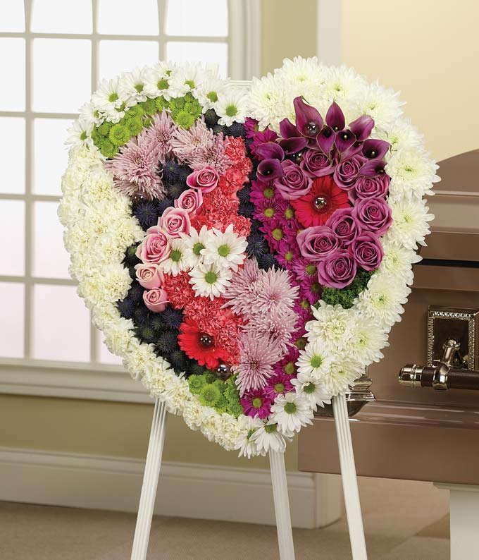 Heart shaped sympathy wreath with carnations, roses and daisies