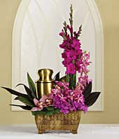Funeral arrangement of purple dahlias, orchids and gladiolus