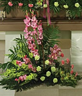 Funeral flower basket with pink and green gladiolus
