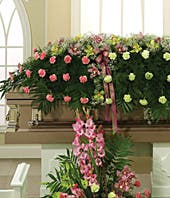 Pink carnations and orchid casket spray