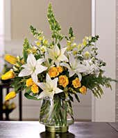 White lilies, yellow tulips and yellow rose florist delivered flowers