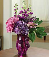 Purple hydrangea, purple roses and calla lilies