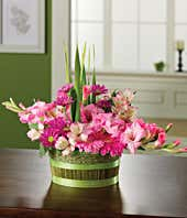 Flower basket with pink gerbera daisies, pink alstroemeria and gladiolus