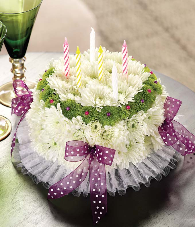 Happy Birthday flower cake with white carnations, green poms and bows