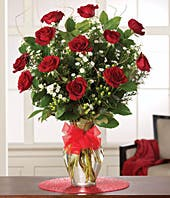 One dozen long stem red roses with hypericum