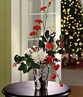 Red mini carnations, white mums and holly Christmas arrangement
